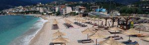 himara panorama 300x91 - Hinata, Albania. June, 2018: Aerial View To Potami Beach In Town Of Himara In Albania. Scenic View T